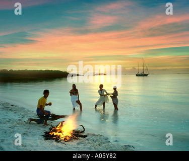 BS - GRAND CAY: Group of young people having barbeque on beach - Stock Photo