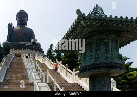 Huge bronze statue of Buddha at the Po Lin Monastery on Lantau Island in Hong Kong - Stock Photo
