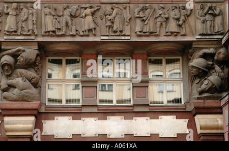 Marble frieze relief on side of Banka legii building Na Porici street in central Prague Czech Republic - Stock Photo
