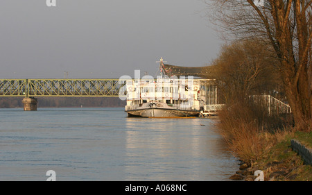 A side view of a ship anchored near the harbor Danube Austria - Stock Photo