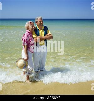 Middle Aged Couple Paddling - Stock Photo