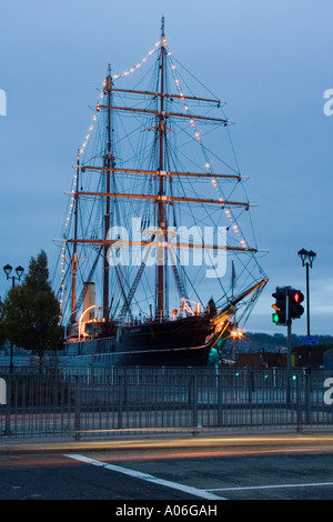 Christmas lights and decorations lighting up the RRS Discovery ship at night in Dundee, UK - Stock Photo