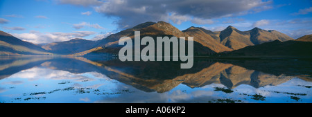 the Five sisters of Kintail reflected in Loch Duich nr Shiel Bridge Wester Ross Western Highlands Scotland UK - Stock Photo