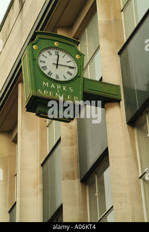 Antique Synchronome clock outside Marks & Spencer in Parliament Street, York, England, UK - Stock Photo
