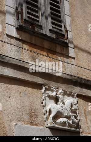 Wall carving of Saint George and the Dragon Piran Slovenia - Stock Photo