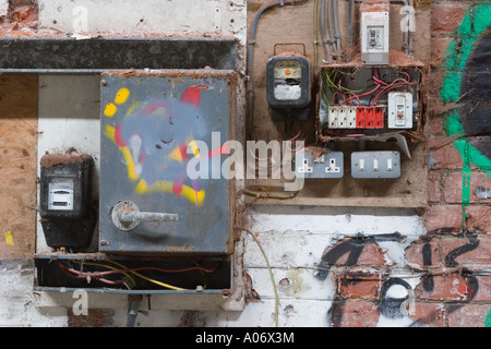 Old electrical installation fuse board and distribution board with wylex switchgear. - Stock Photo