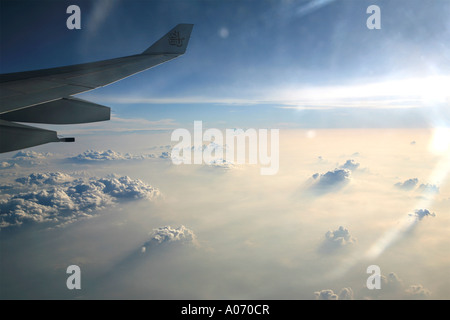 dramatic clouds as taken from high above in an airplane - Stock Photo