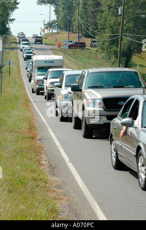 Line of vehicles on 2 lane road stopped due to congestion - Stock Photo