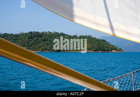 View of Pigs Island from sailboat Veleiro Azul Angra dos Reis state of Rio de Janeiro Brazil - Stock Photo