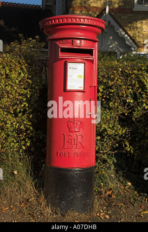 Traditional British Post Box in Rural Village - Stock Photo