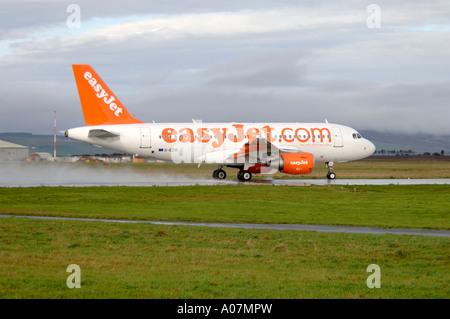 Easy Jet on Runway - Stock Photo