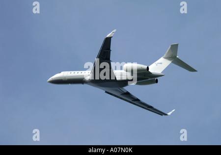 Dassault Falcon 900 super large Tri Jet departing Inverness Dalcross Airport.  XAV 3990-380 - Stock Photo