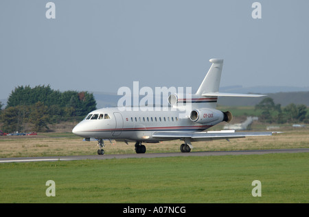 Dassault Falcon 900 super large Tri Jet departing Inverness Dalcross Airport.  XAV 3994-380 - Stock Photo