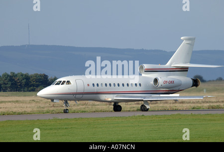 Dassault Falcon 900 super large Tri Jet departing Inverness Dalcross Airport.  XAV 3995-380 - Stock Photo