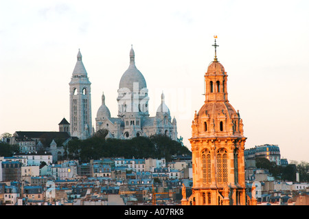 Paris France, Overview 'Sacre Coeur' Basilica on Montmartre Hill with 'Holy Trinity Church' Cityscape, urban landscapes, - Stock Photo