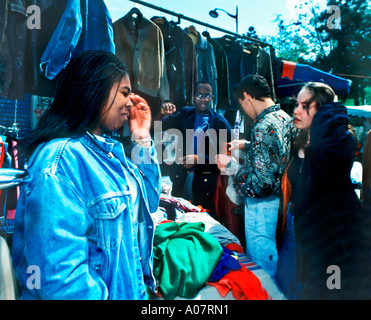Multicultural Paris France, Shopping Mixed Group of French Teens in Used Clothes Shop in Clignancourt Flea Market, - Stock Photo