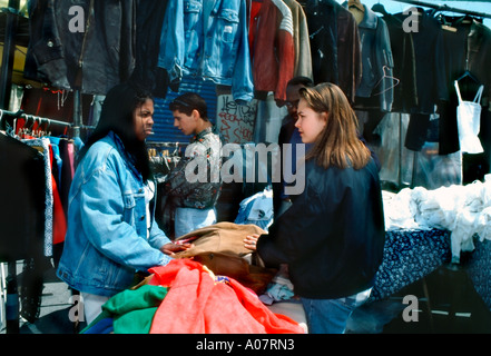 Paris France, Shopping Mixed Group of French Teens in Used Clothes Shop in 'Porte de Clignancourt' Flea Market, - Stock Photo