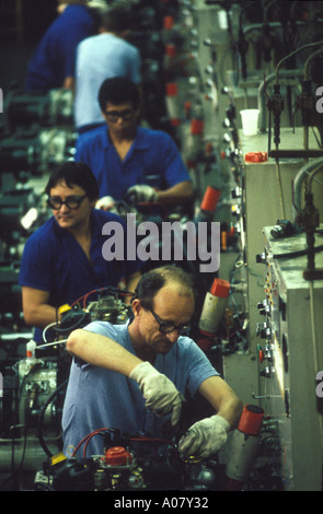 Automobile industry workers in an assembly line Skilled laborers wearing safety gear Economic development São Paulo - Stock Photo