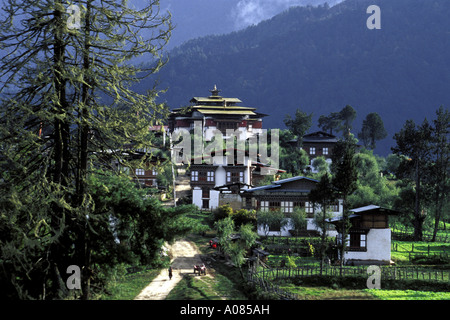 The Gompa or Monastery Dominates the Tiny Town of Gangtey in the Phobjika Valley of Central Bhutan - Stock Photo