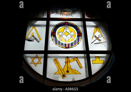 Freemasons masonic symbols, Close up of a plate glass window showing masonic symbols in a Freemasons Lodge - Stock Photo
