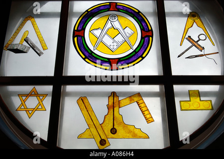 Close up of a plate glass window showing masonic symbols in a Freemasons Lodge - Stock Photo