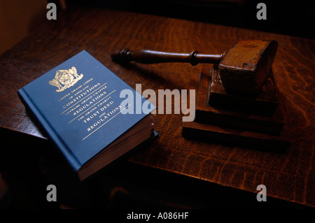 Close up of book and gavel in a Freemasons Lodge - Stock Photo