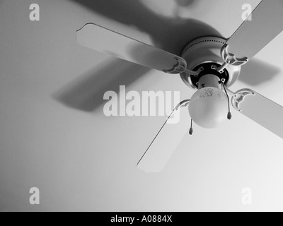 Detail view of a ceiling fan accentuating the shadows - Stock Photo