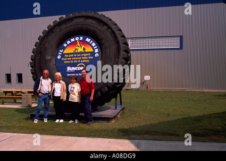 Giant Tire from Mining Truck, recycled as Suncor Work Site Safety Sign, in Athabasca Tar Sands near Fort McMurray - Stock Photo