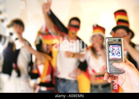 Gruppe deutscher Fussball Fans, group of German football fans - Stock Photo