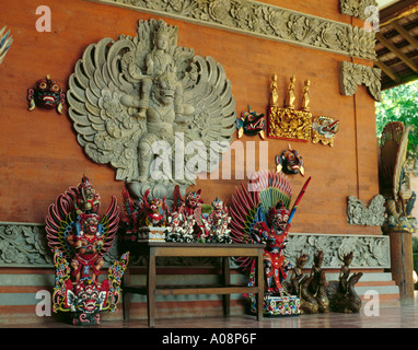 Display of local handicrafts and ornate wall decoration on a house, Bali, Indonesia, Asia. - Stock Photo
