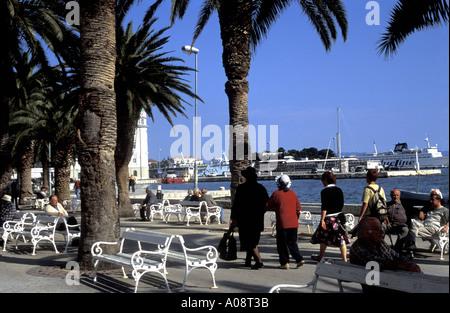 Afternoon Promenade The Riva Waterfront overlooking the Harbour The Adriatic Sea Split Dalmatia Makarska Riviera - Stock Photo