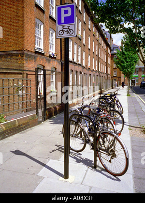 Cycles parked in a specially designated area in central London England UK - Stock Photo