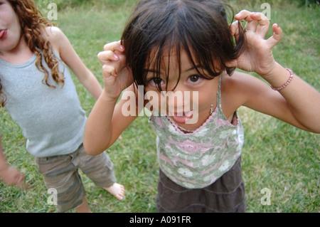 Girls Making Faces - Stock Photo