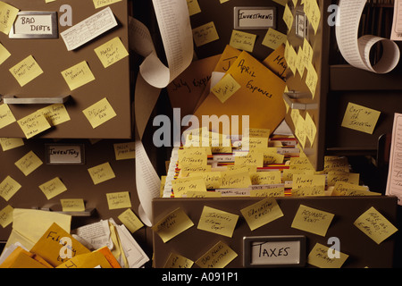 Small Business overload tax time pressure out of control filing system cabinets - Stock Photo