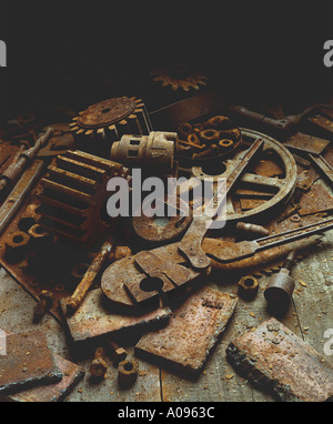 Metal Rusted steel parts and rusted tools in factory or machine shop work table or scrap setting - Stock Photo