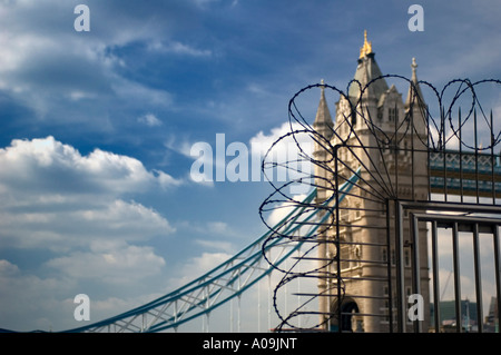 Tower Bridge in Summer With Barbed Wire Fence Obscuring View, London - Stock Photo