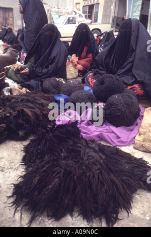 Saudi Arabia, Asir Province. Women selling wool in Jaizan market - Stock Photo