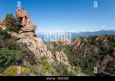 Les Roches Rouges (Red Rocks) on the coast road between Piana and Porto, Gulf of Porto, Corsica, France - Stock Photo
