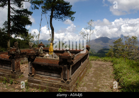 hillside Hindu temple, place of worship, Trees and mountainous skyline, interior of Bali Indonesia - Stock Photo