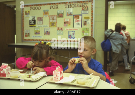 Students at elementary school morning breakfast program model released - Stock Photo