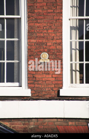 Fire Mark of fire plaque used for insurance purposes in the C19th and C19th found on Bootham York UK - Stock Photo