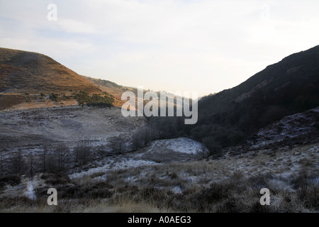 Looking down the eastern spur of the Cheesden Valley towards the remains of Birtle Dean Mill in the North Pennine - Stock Photo