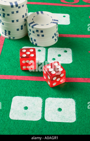 Poker chips and red gambling dice - Stock Photo
