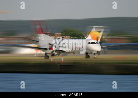 Swiss International Air Lines Saab 2000 HB IZH London City Airport UK - Stock Photo