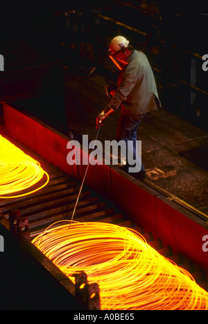 Steel rod being coiled for use as wire at Northwestern Steel in Illinois Other steelmaking shots available - Stock Photo