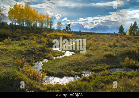 Small stream with fall color and Teton Mountains Grand Teton National Park Wyoming - Stock Photo