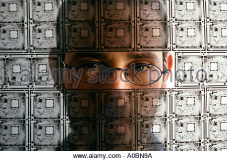 Person looking through transparent electric circuit board - Stock Photo