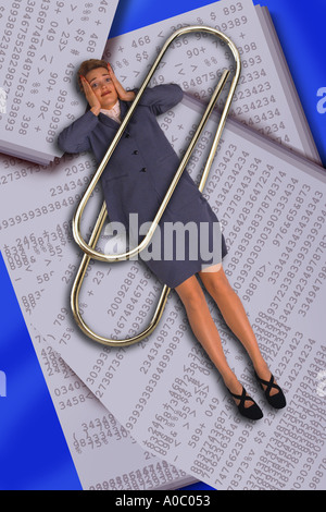 Business woman trapped in paper clip - Stock Photo