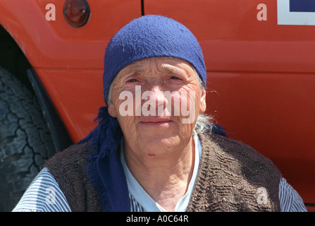 Stock image of a Kosovar woman with scarf in refugee camp - Stock Photo