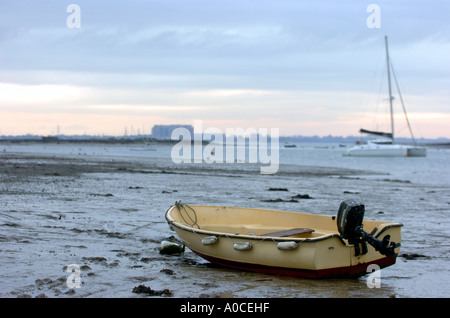 West Mersea boats resting on the mud flats on shoreline of the Strood Channel close to the River Blackwater estuary - Stock Photo